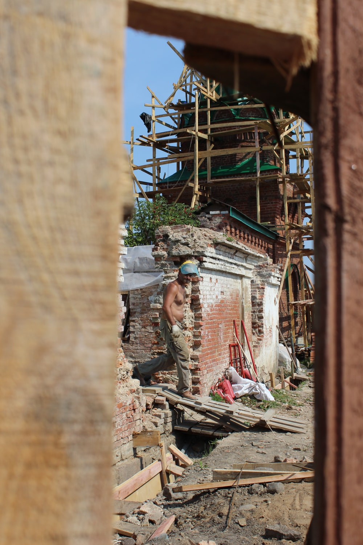 man walking on ramp beside wrecked building
