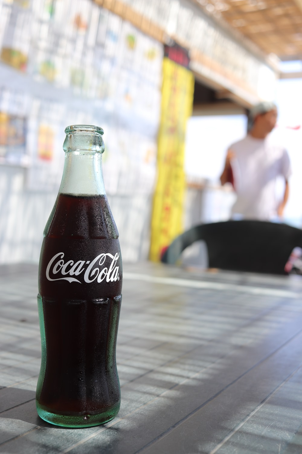 Coca-Cola bottle on table