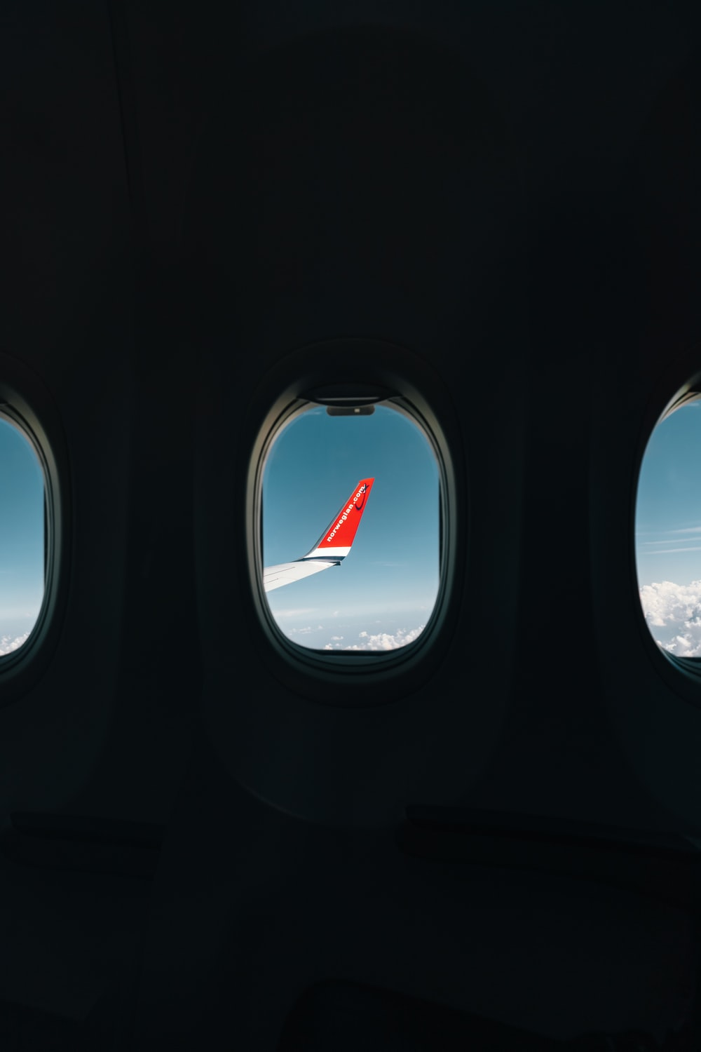 red airplane wing through window
