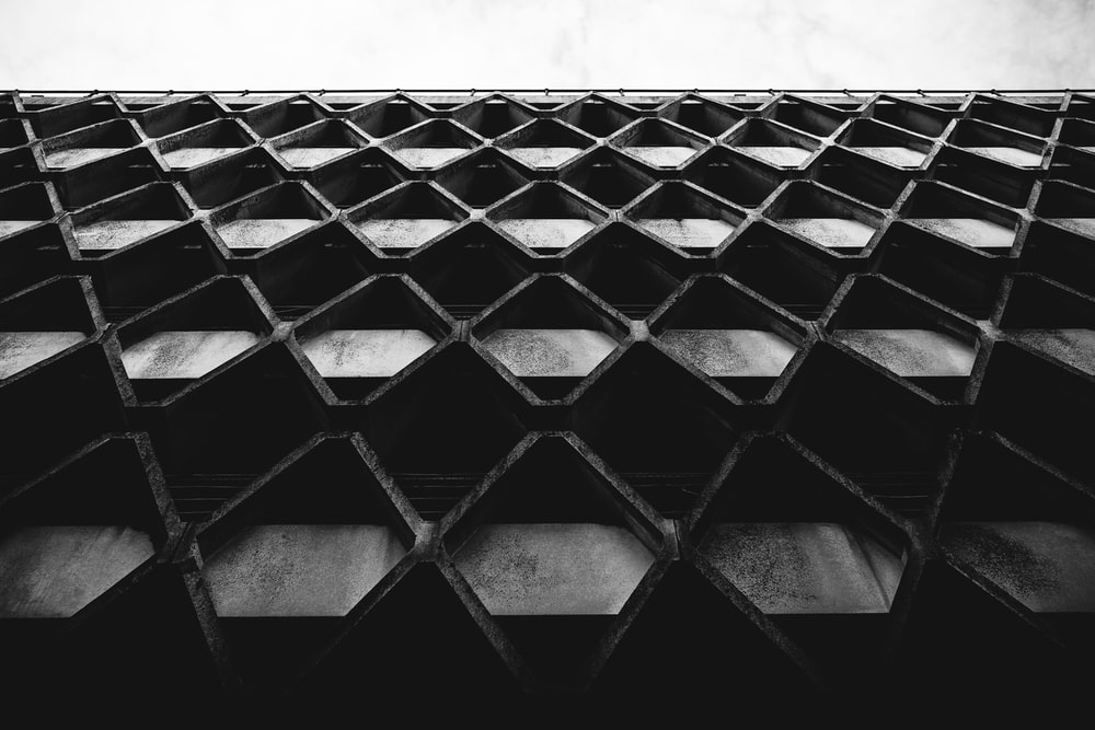 low-angle photography of black building