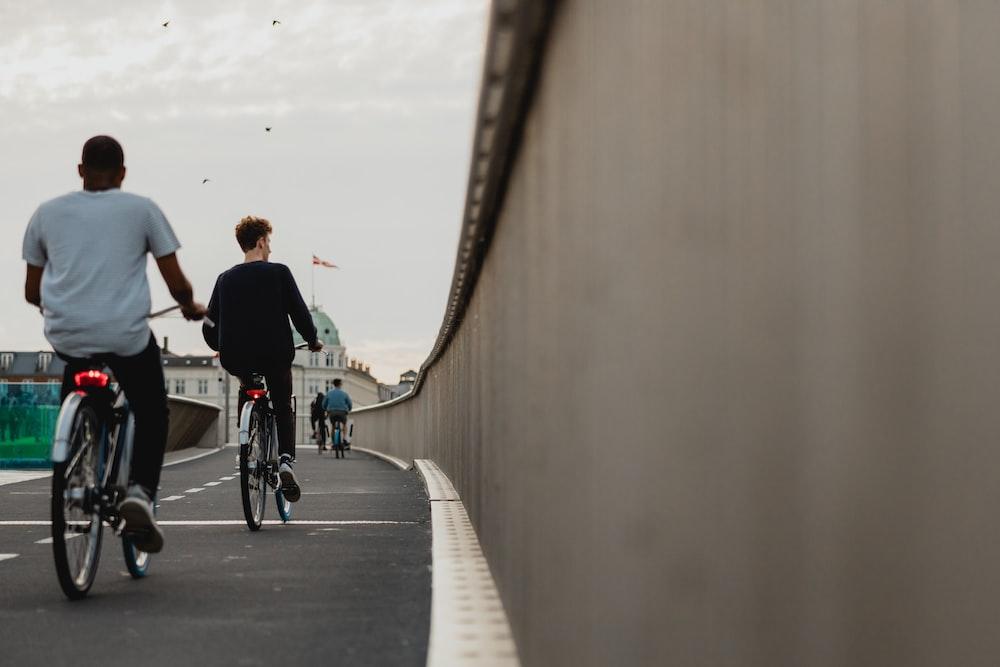 people biking on road during daytime