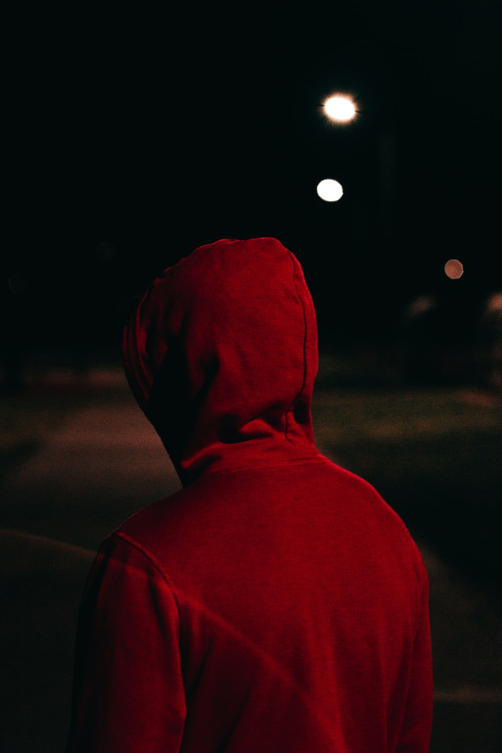 person in red hoodie