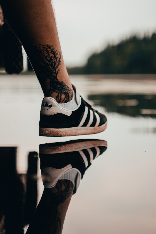 black Adidas low-top sneaker