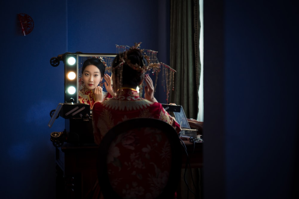 woman sitting in front of the mirror