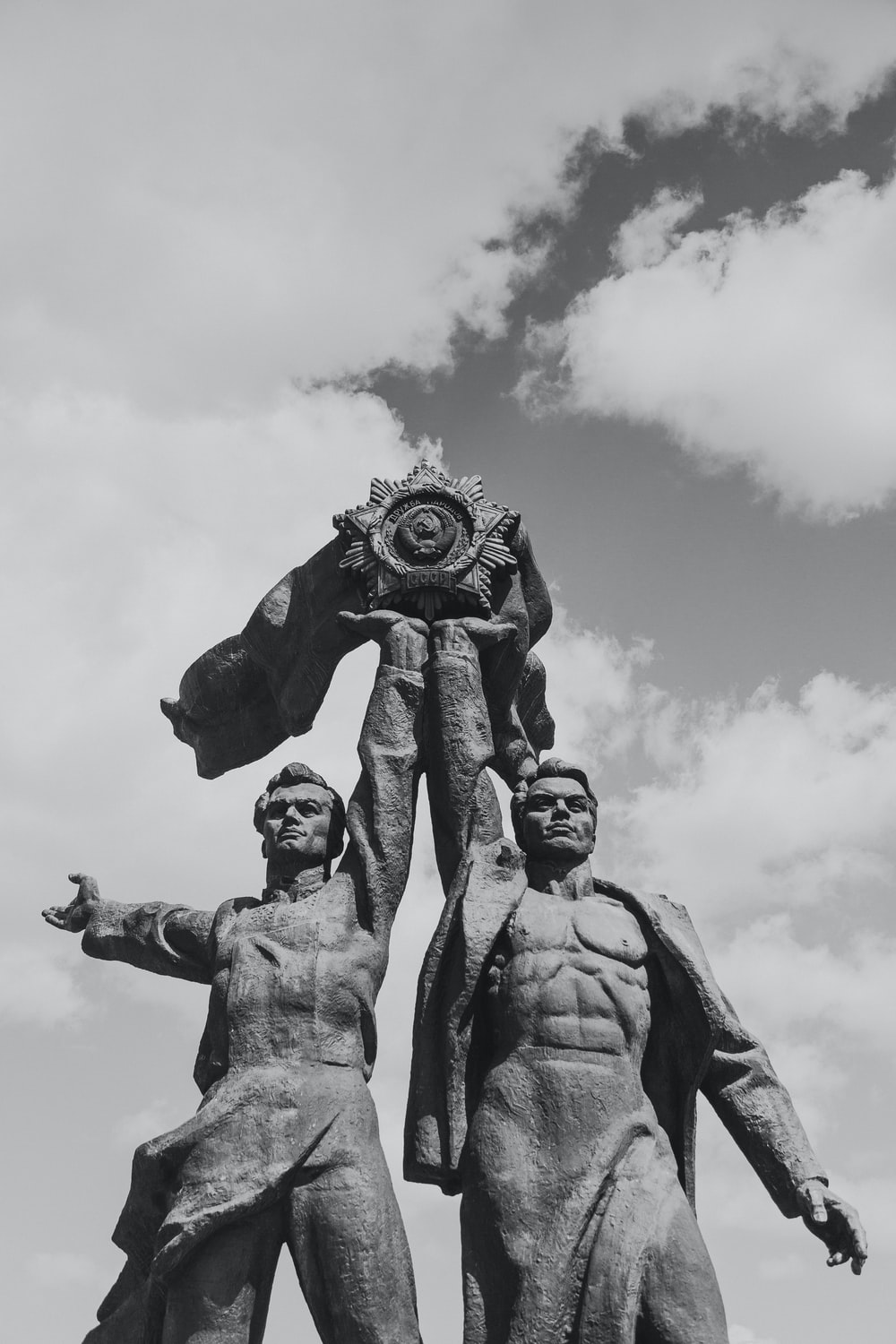 grayscale photo of two men statue