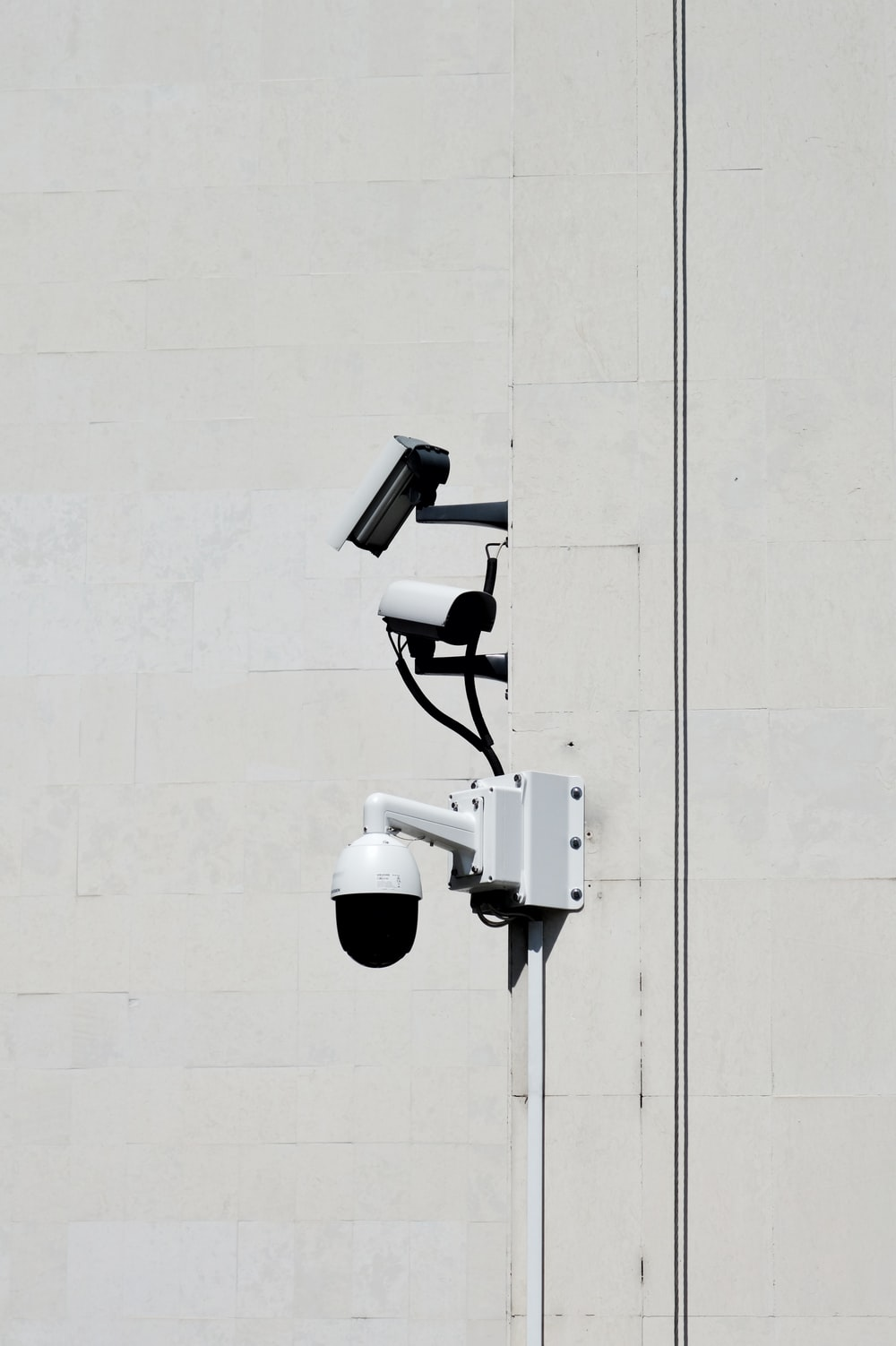white CCTV cameras during daytime