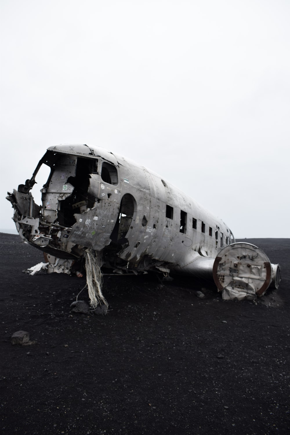 grayscale photo of wreck plane