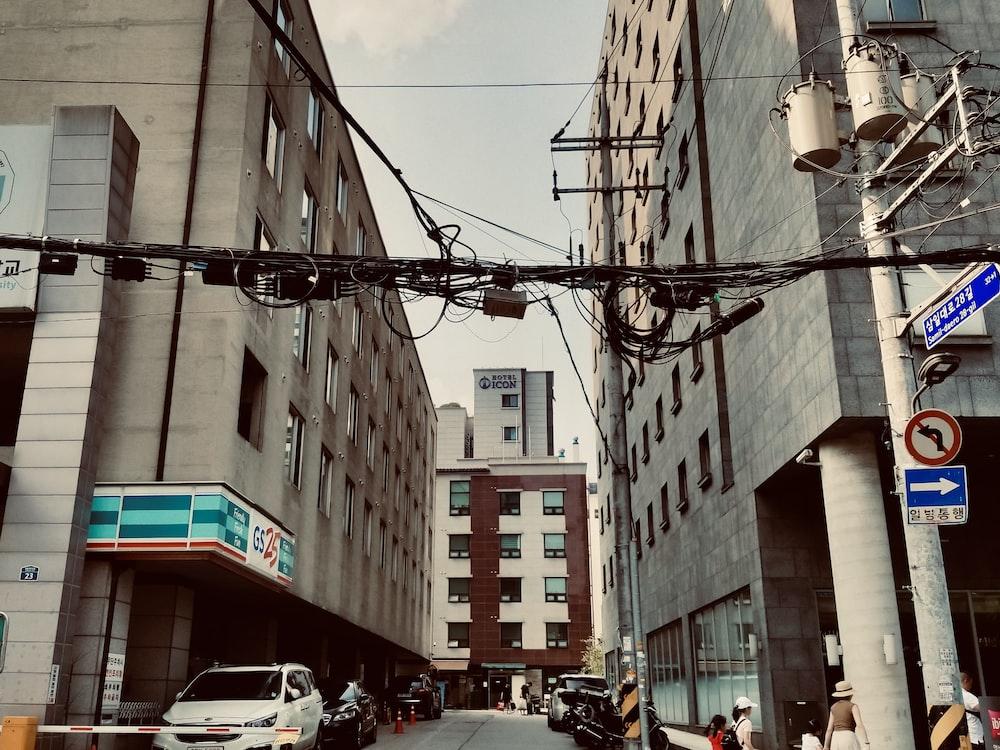 vehicles beside buildings