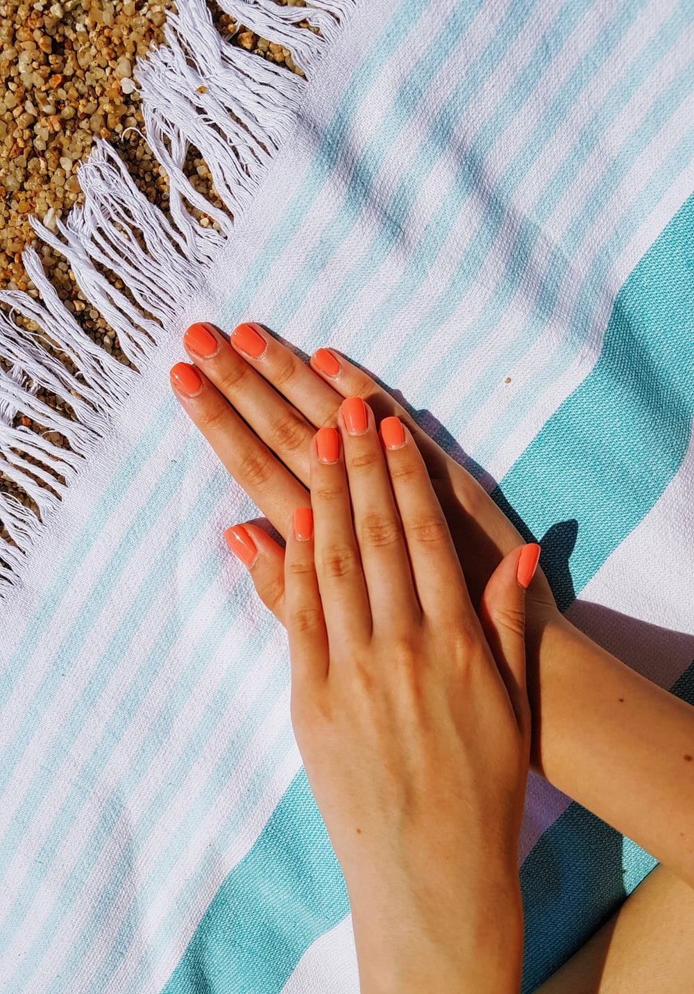 person's hands putting on towel