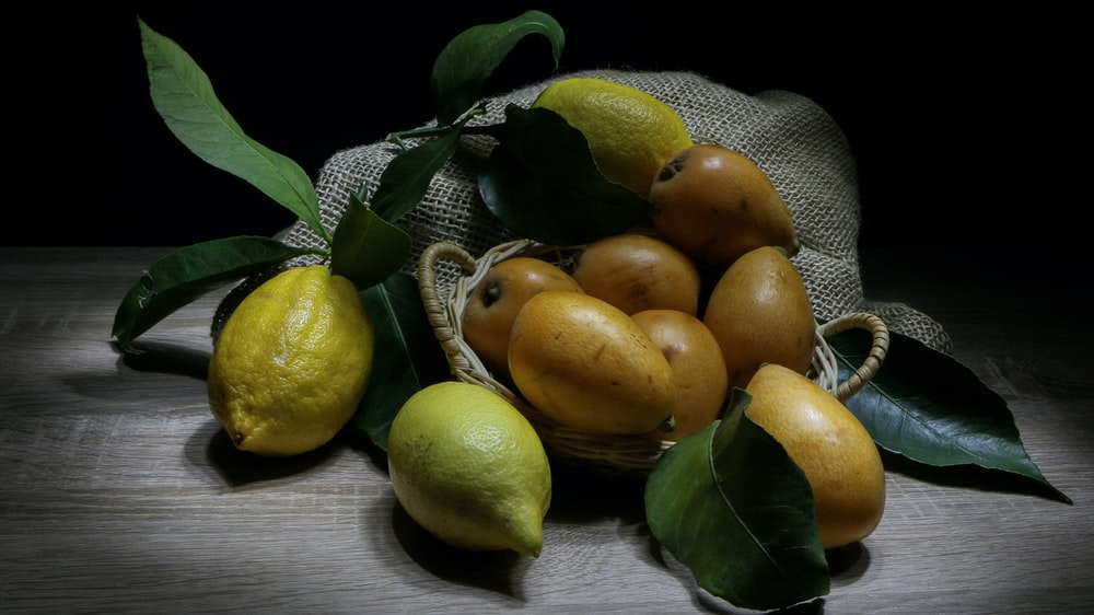 yellow fruits on brown surface