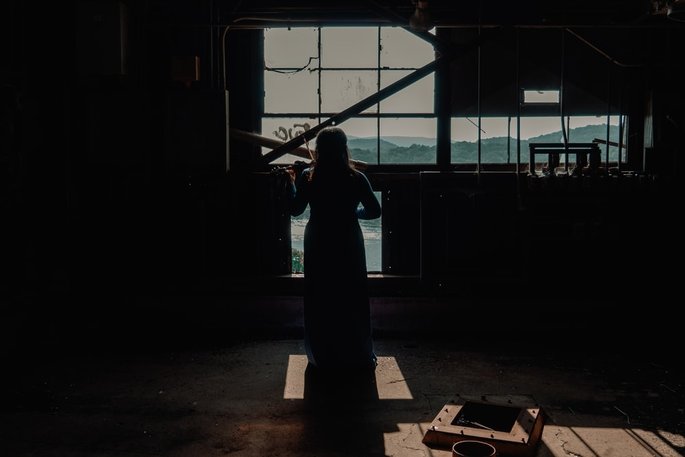 woman standing infront of window