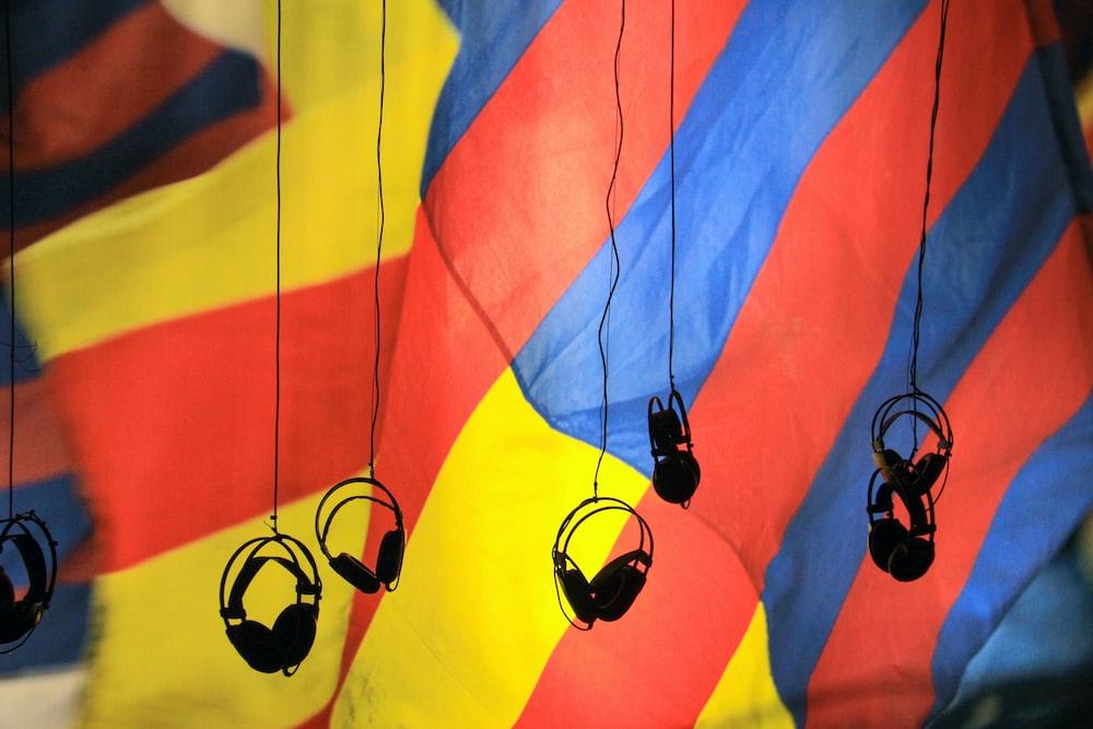 black headsets hanging