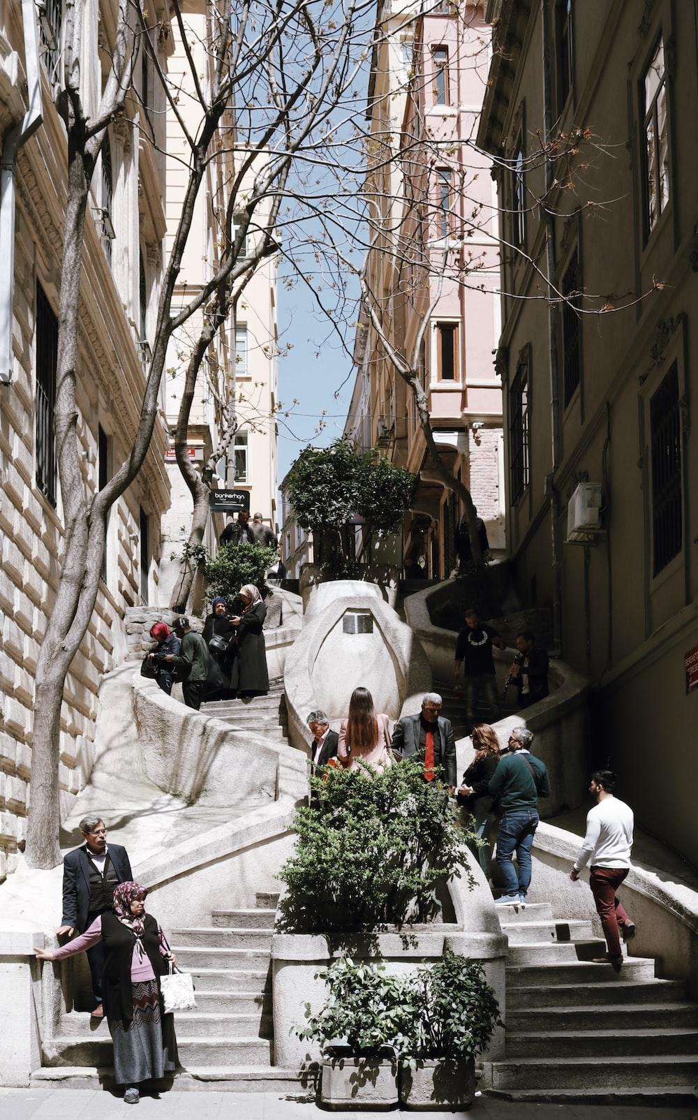 people walking on stairway during daytime