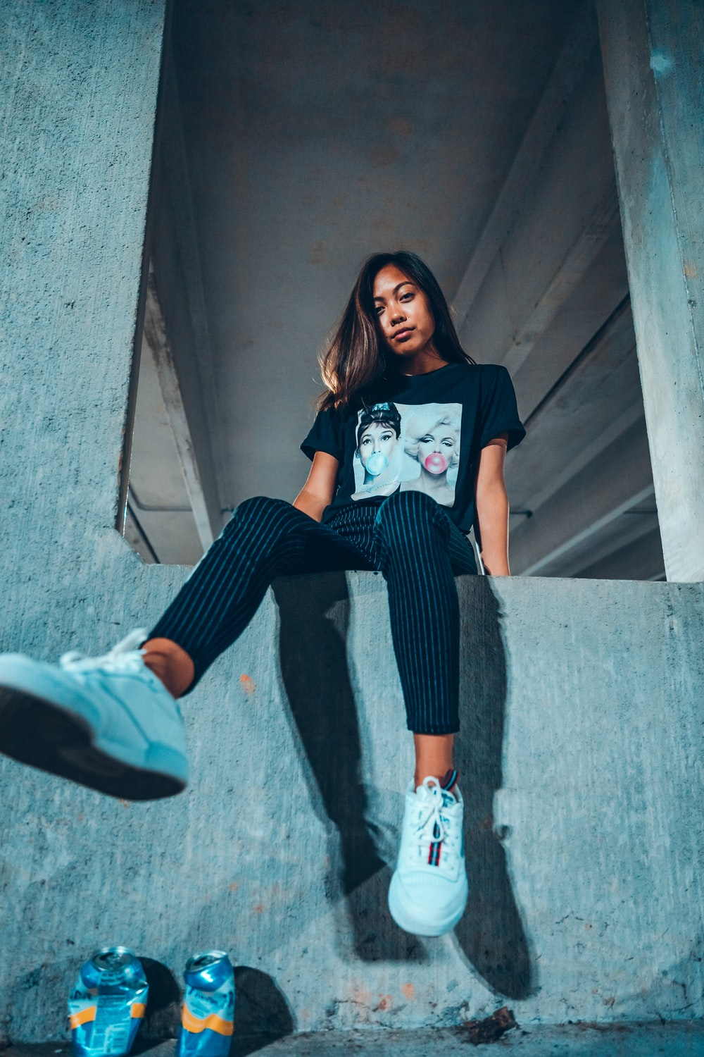 sitting woman wearing black and white crew-neck t-shirt