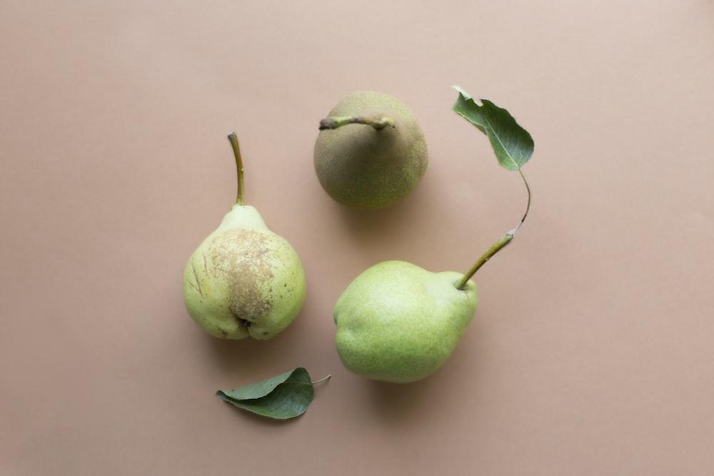 three yellow peach fruits
