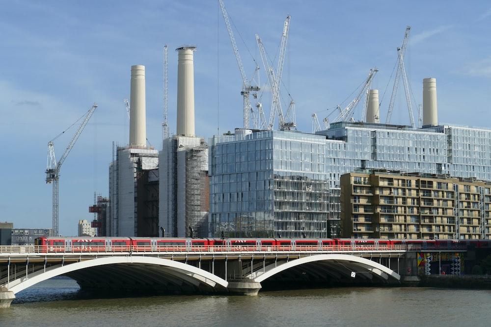concrete high rise buildings beside bridge at daytime