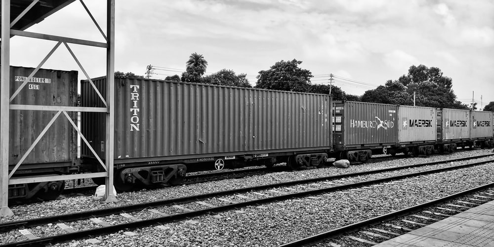 grayscale photo of gray and white train