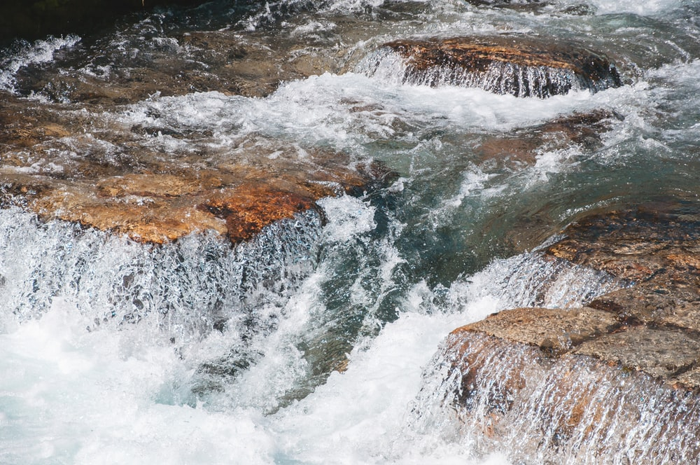 water flowing on river at daytime