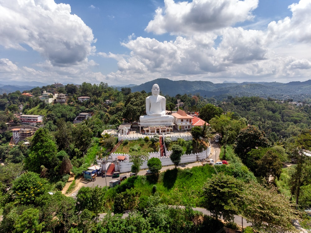 Gautama Buddha statue under white clouds