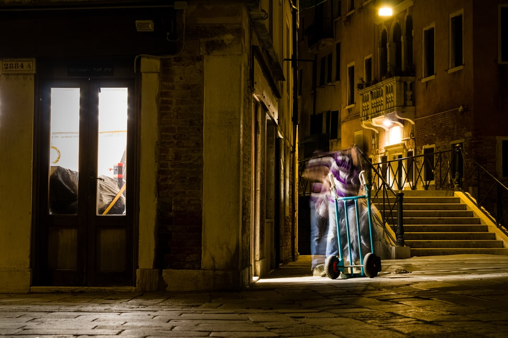 person beside store facade