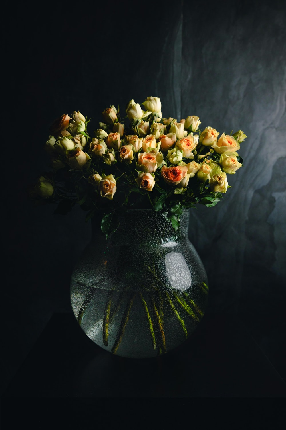 yellow flowers with vase