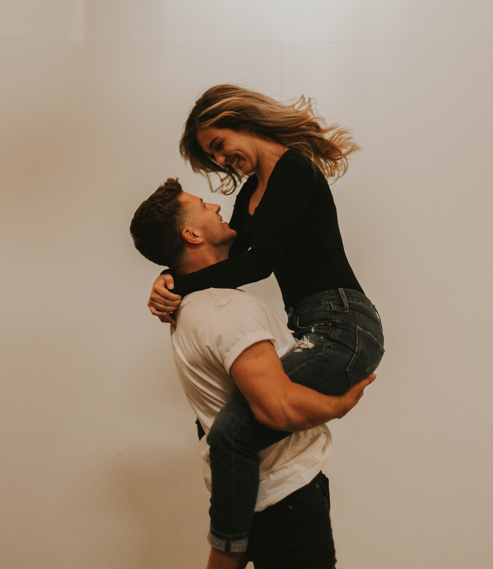 man carries woman