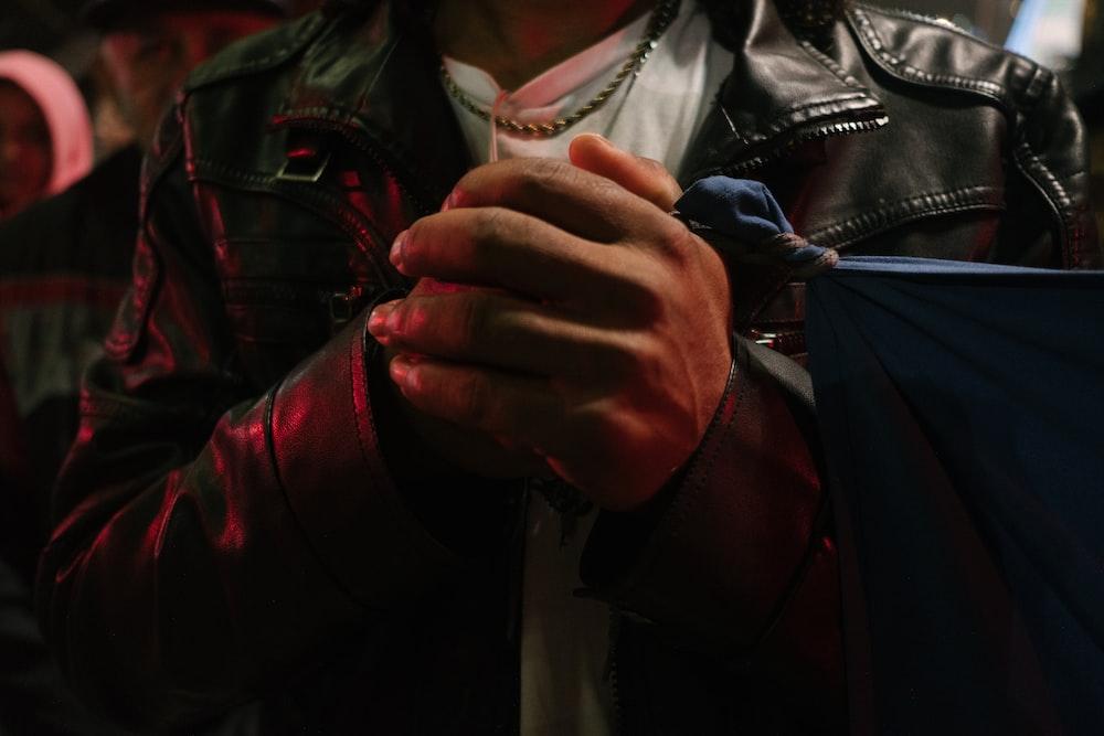 man wearing black leather jacket
