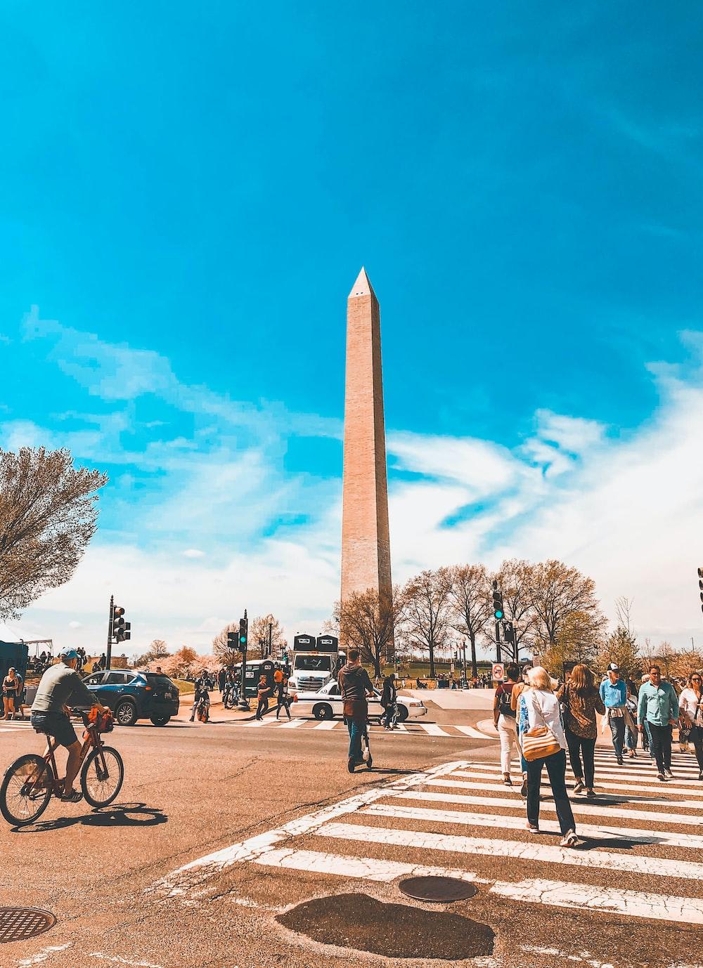 people standing across brown Obelisk