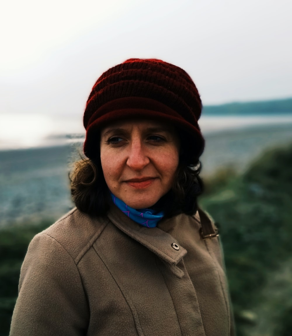 woman in red knit cap