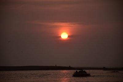 Thiruvananthapuram silhoette of boat on sea water during daytime