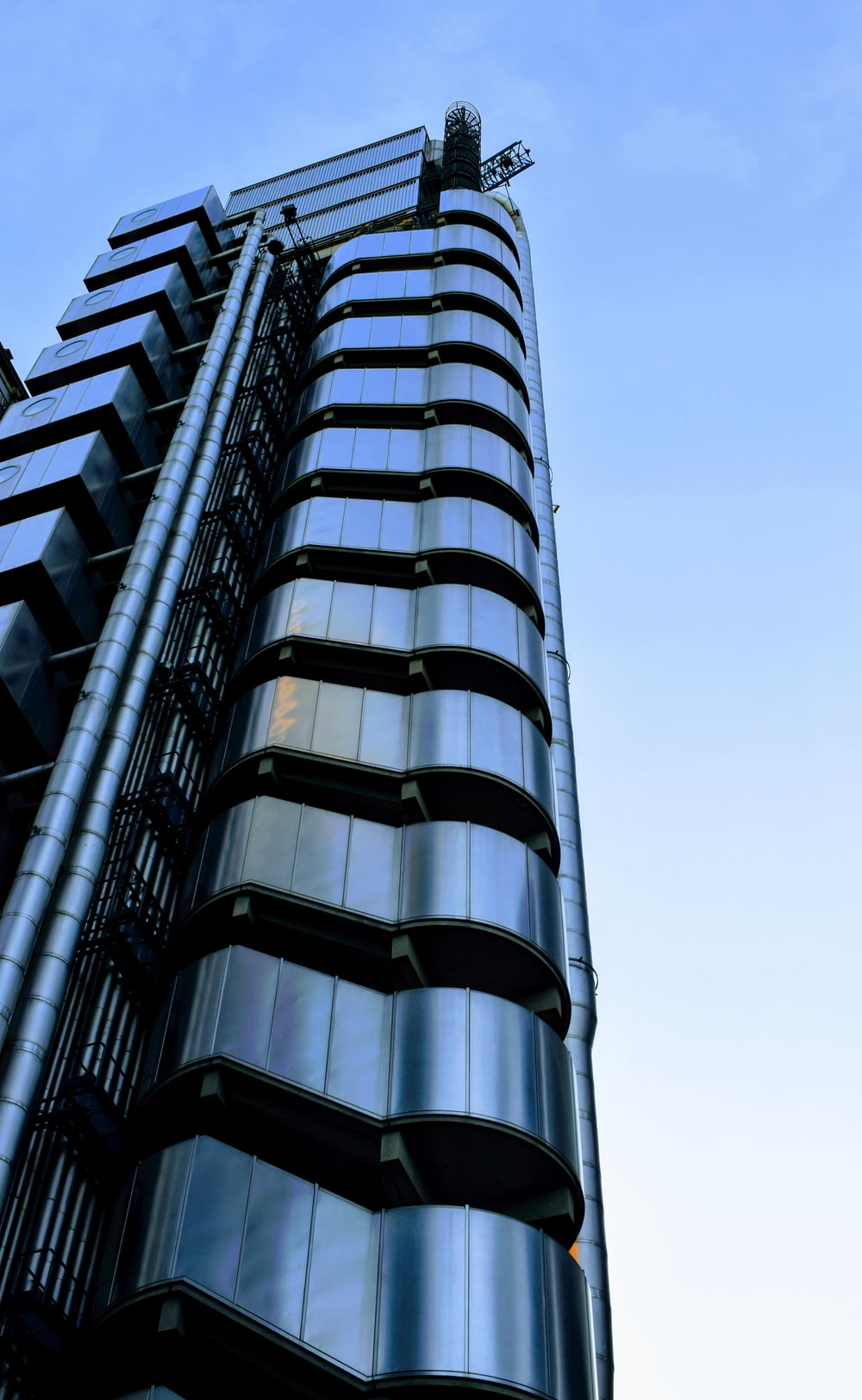 low-angle photo of silver building