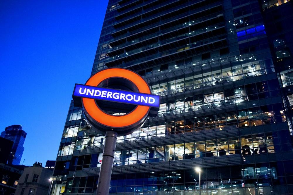 orange and blue Underground signboard