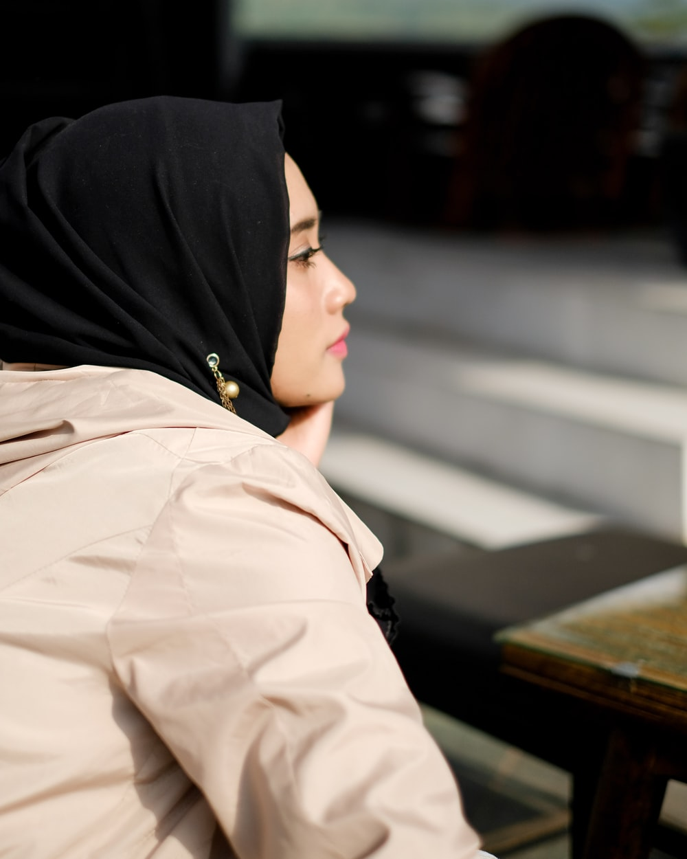 woman sitting infront of table