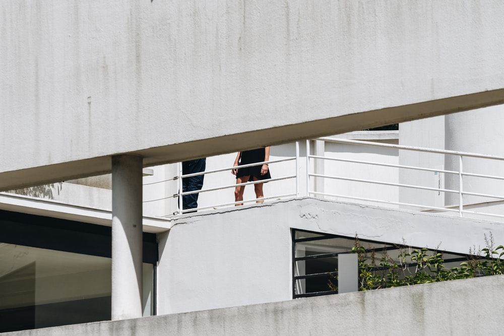 two people standing on terrace during daytime