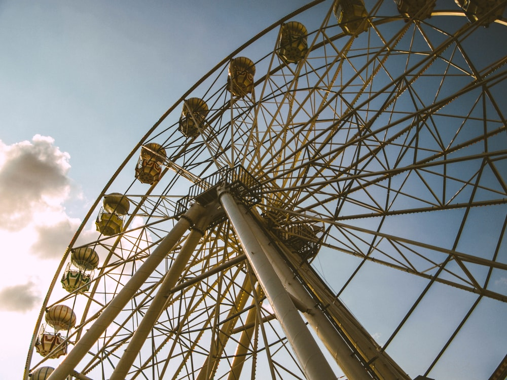 white and brown ferris wheel close-up photography
