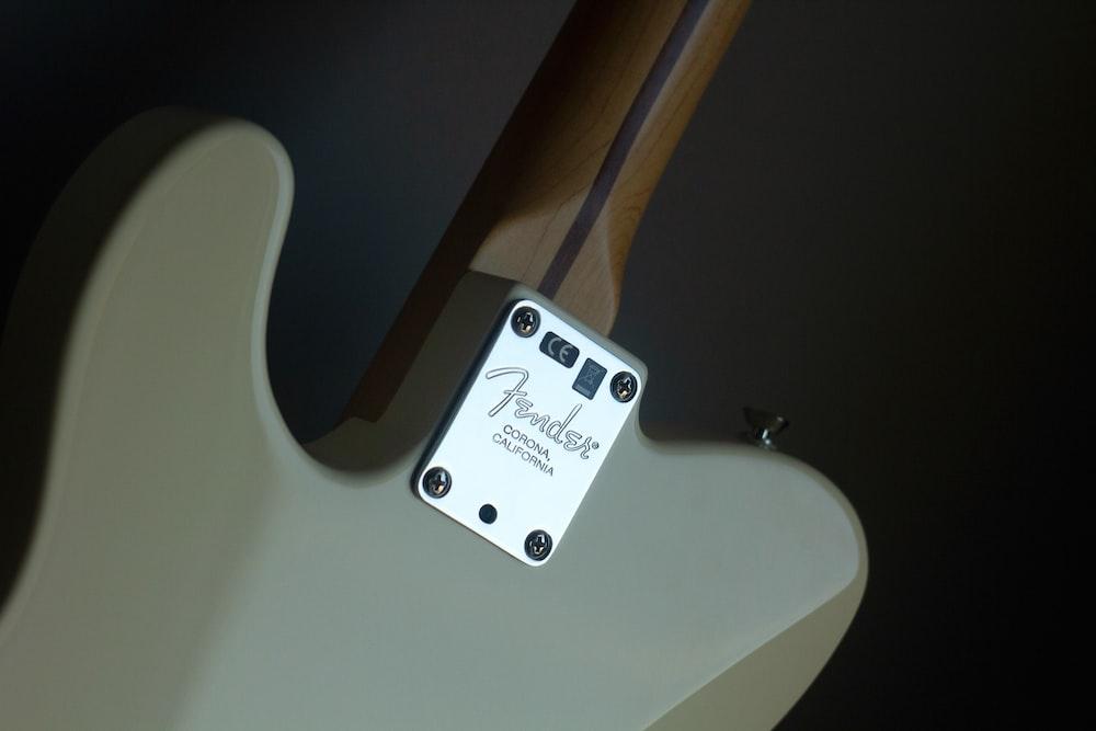 white Fender electric guitar
