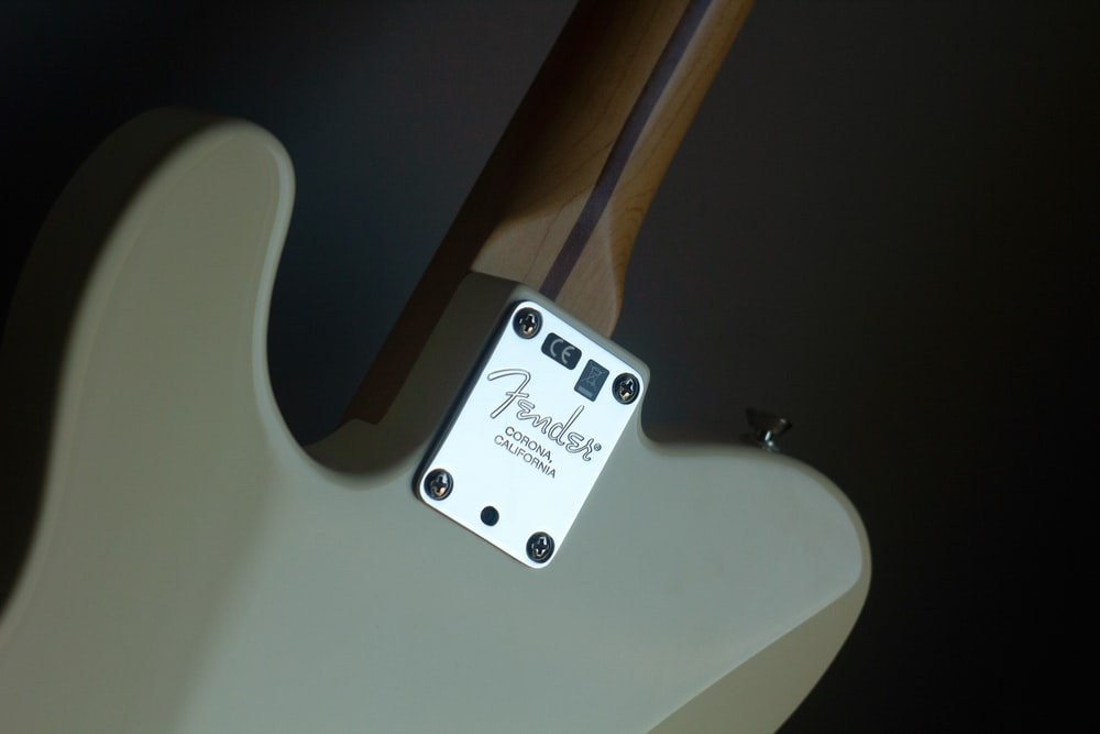 white Fender electric guitar