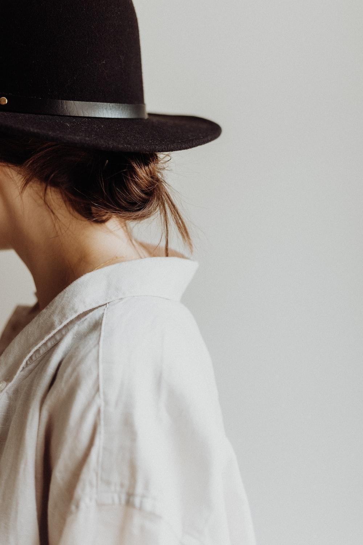 woman wears black hat