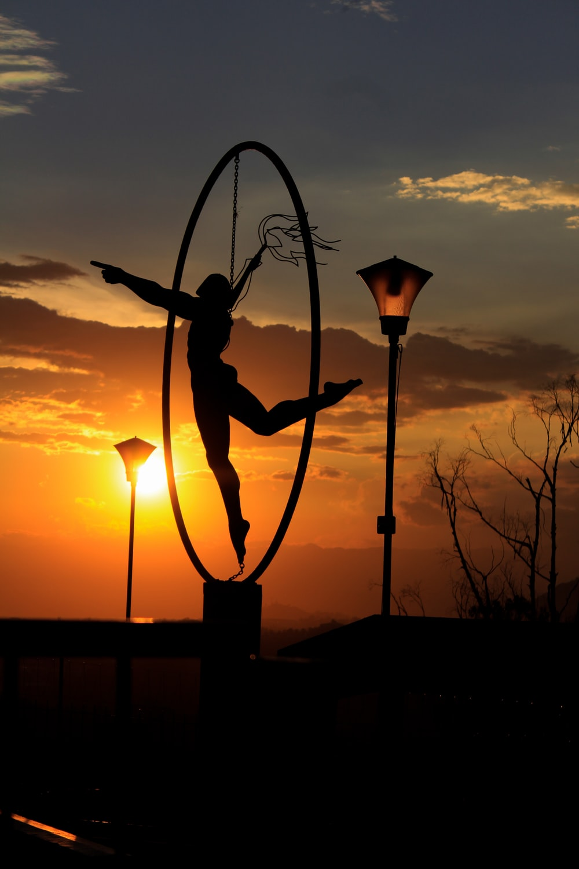 silhouette of woman near light post