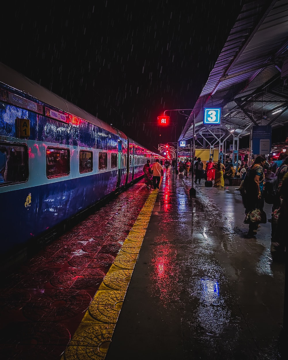 people on train station during nigttime