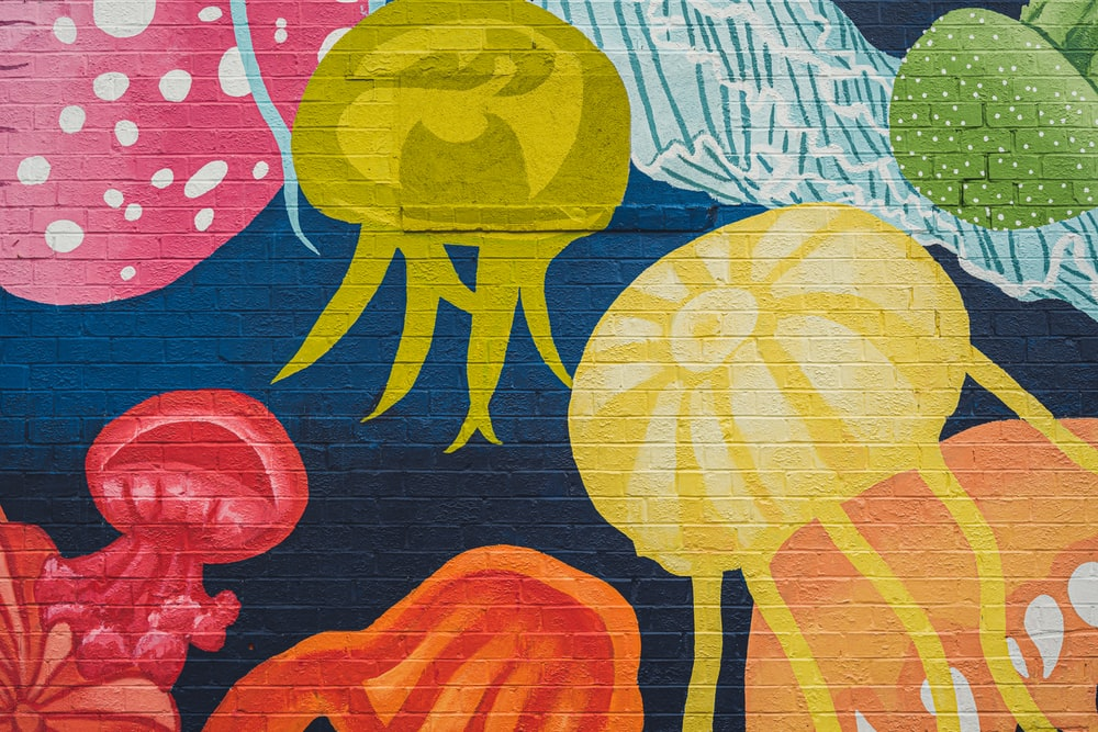 blue, yellow, and red jelly fish print textile