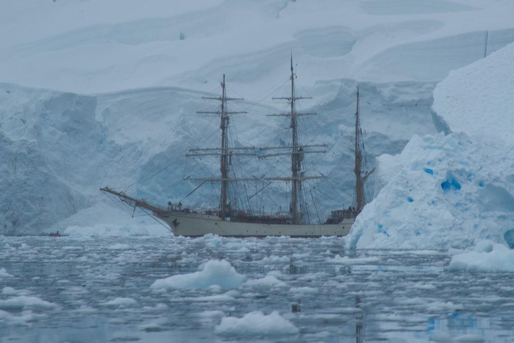 white galleon ship near glaciers