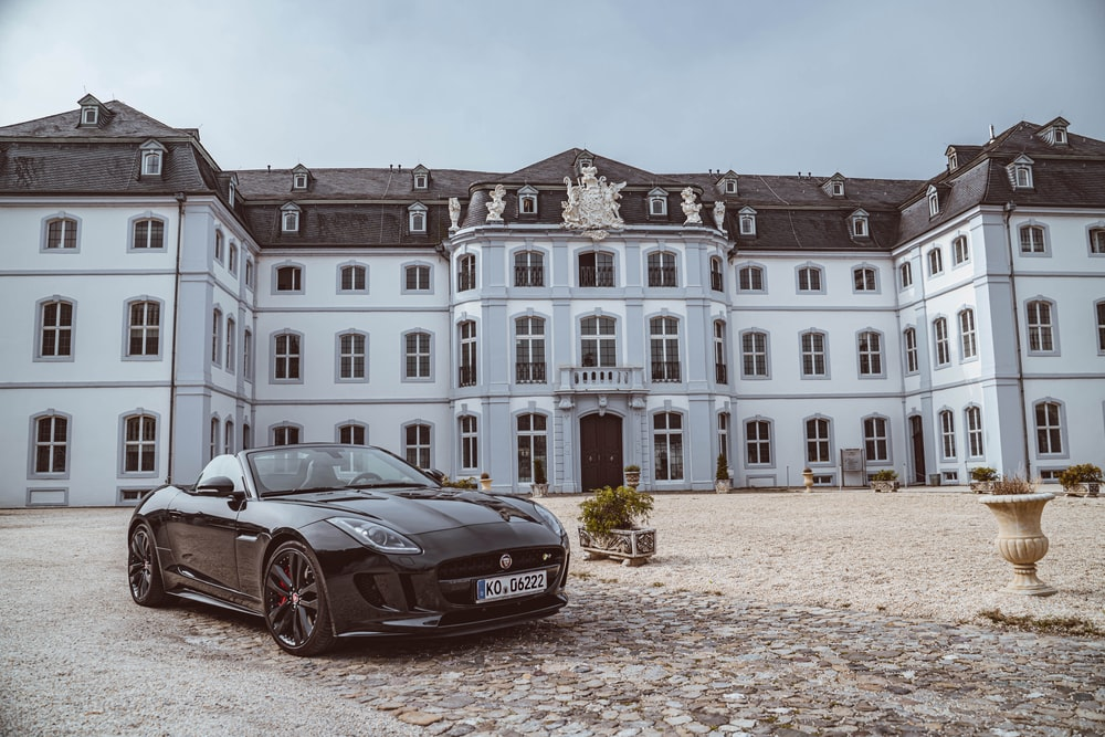 black sports coupe near building