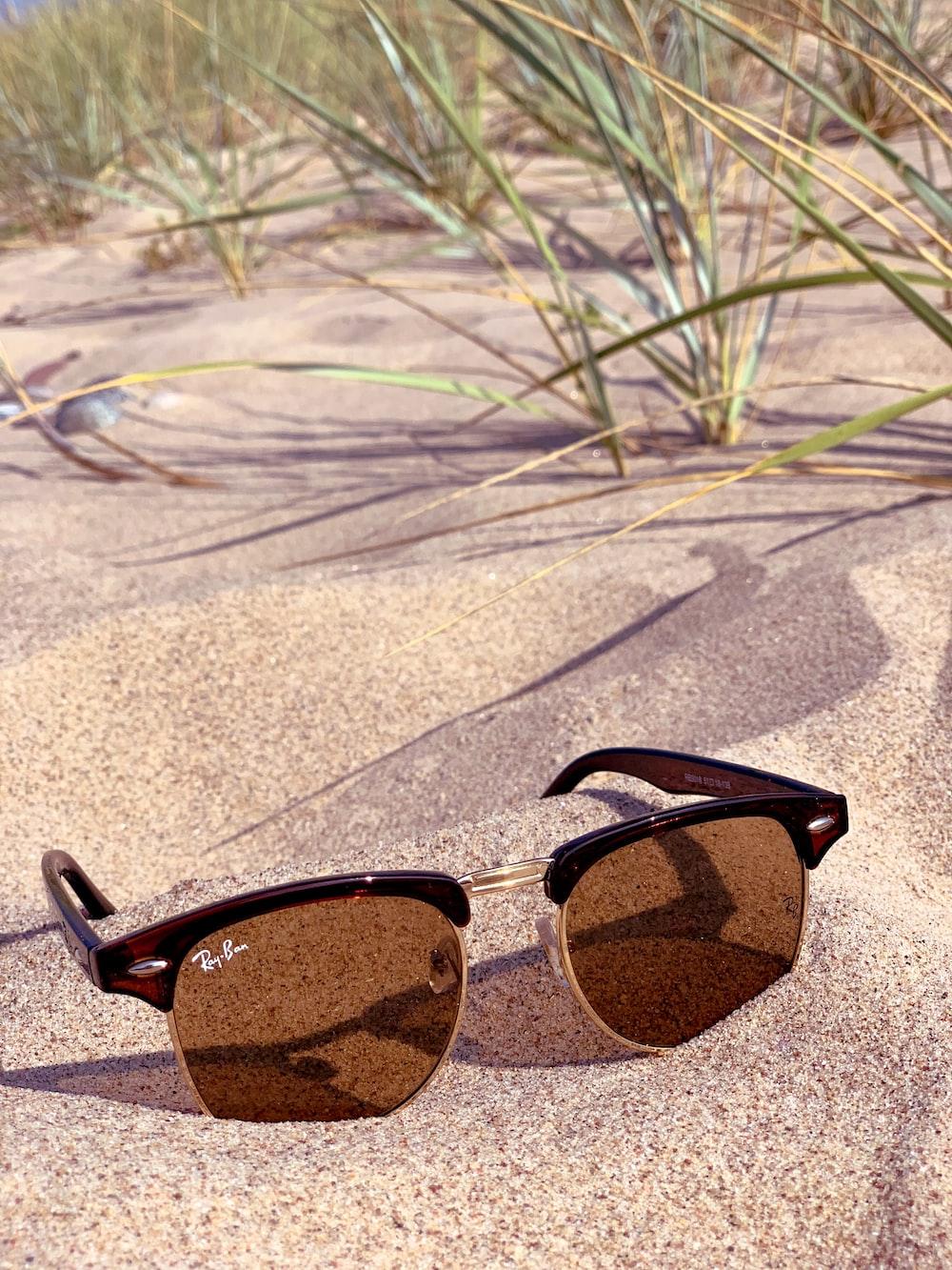 black framed brown lens sunglasses