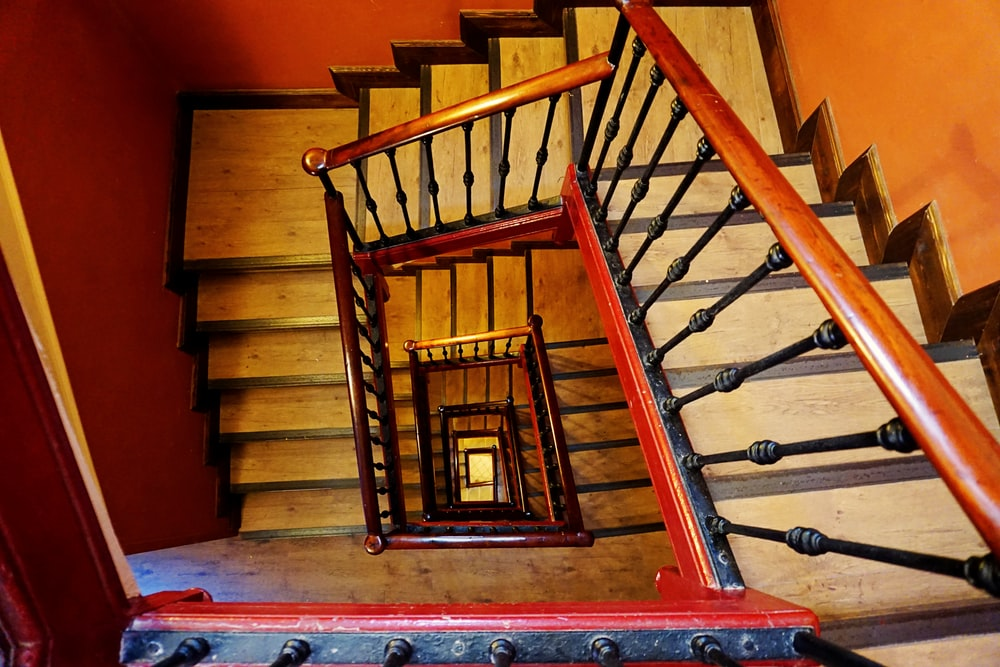 gray staircase with brown wooden railings