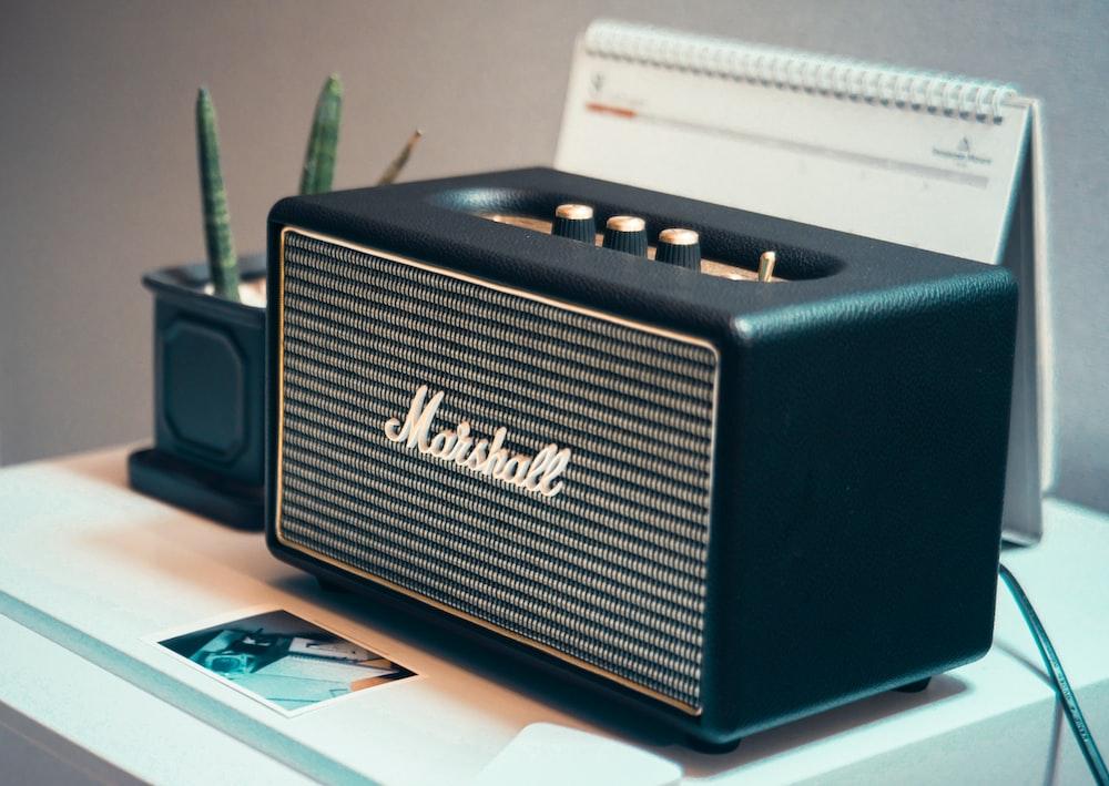 black Marshall speaker on table
