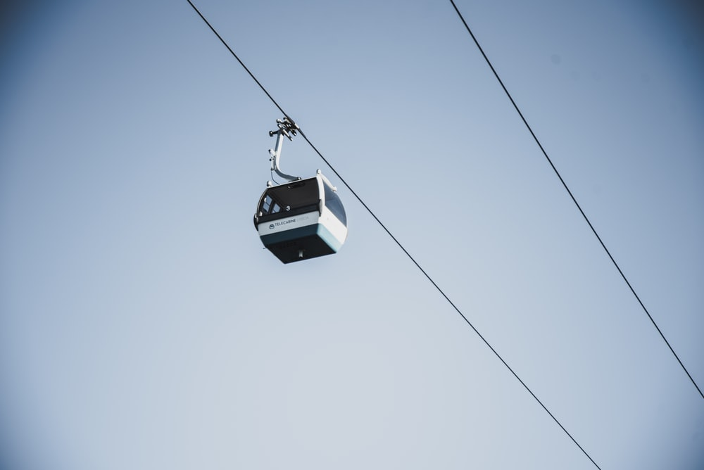 white and black cable car during daytime