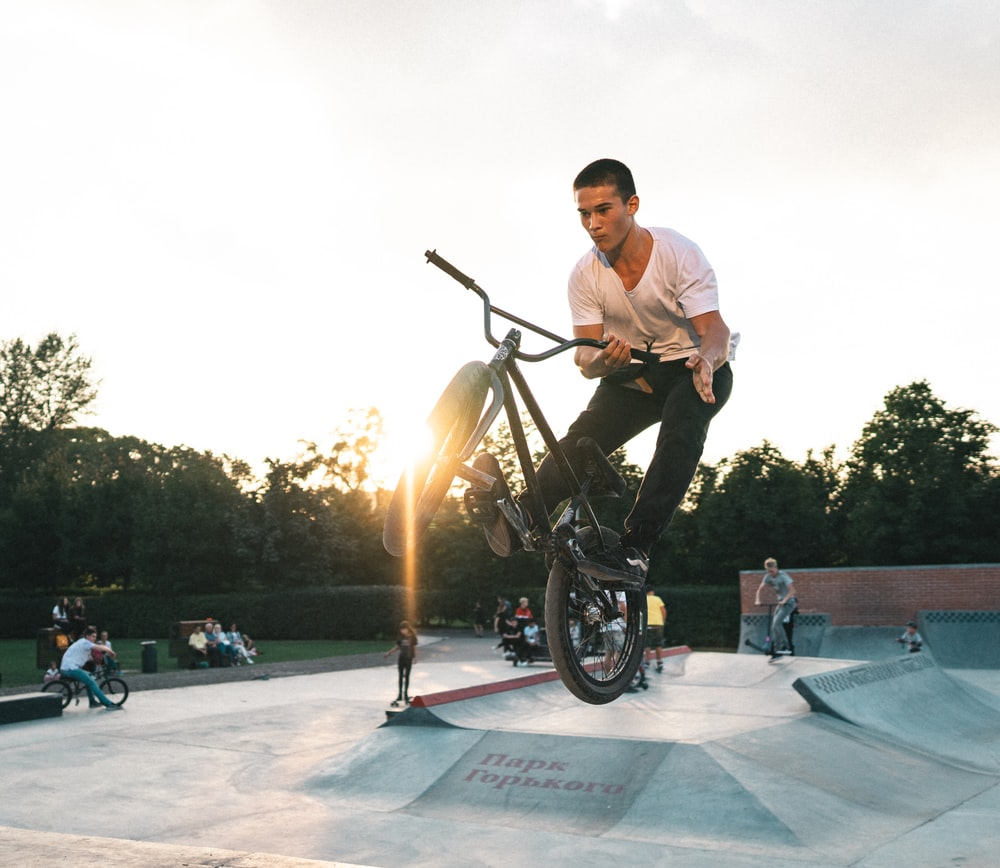 man exhibitioning while riding BMX bike