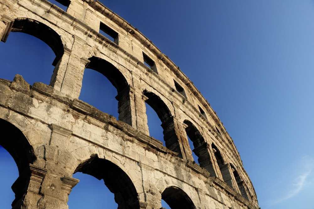 The Colosseum, Rome under blue sky
