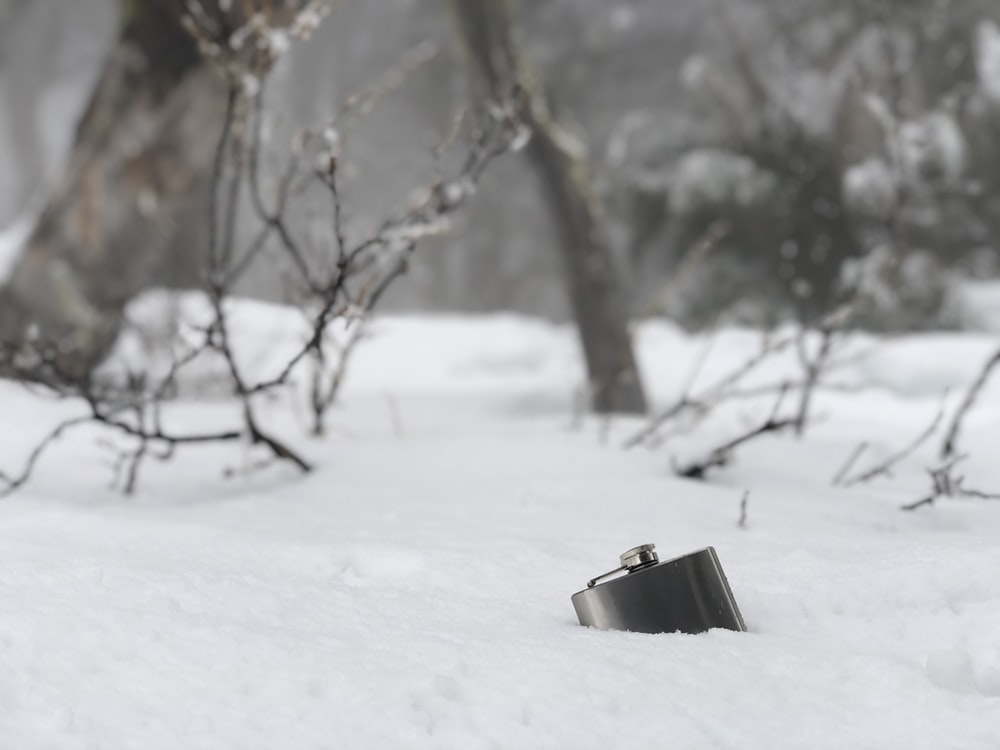 gray flask on icy surface